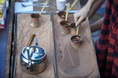 Manufacturing sand coffee in a copper cezve. Turkish coffee, Georgian coffee. royalty free stock photography