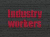 Manufacuring begrepp: Branscharbetare på väggbakgrund Arkivfoton