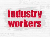 Manufacuring begrepp: Branscharbetare på väggbakgrund Royaltyfri Foto