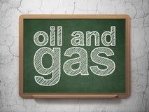 Manufacuring begrepp: Fossila bränslen på svart tavlabakgrund royaltyfri illustrationer