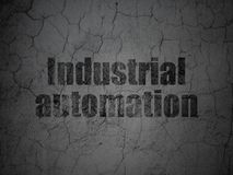 Manufacuring concept: Industrial Automation on grunge wall background. Manufacuring concept: Black Industrial Automation on grunge textured concrete wall Royalty Free Stock Image