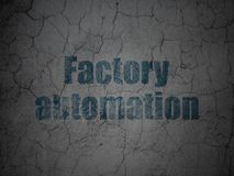 Manufacuring concept: Factory Automation on grunge wall background. Manufacuring concept: Blue Factory Automation on grunge textured concrete wall background Royalty Free Stock Images