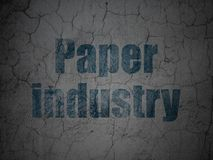 Manufacuring concept: Paper Industry on grunge wall background. Manufacuring concept: Blue Paper Industry on grunge textured concrete wall background stock illustration