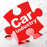 Manufacuring concept: Car Industry on puzzle background. Manufacuring concept: Car Industry on Red puzzle pieces background, 3D rendering Stock Image