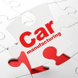 Manufacuring concept: Car Manufacturing on puzzle background Royalty Free Stock Image