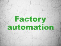 Manufacuring concept: Factory Automation on wall background. Manufacuring concept: Green Factory Automation on textured concrete wall background Royalty Free Stock Images