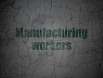 Manufacuring concept: Manufacturing Workers on grunge wall background. Manufacuring concept: Green Manufacturing Workers on grunge textured concrete wall Royalty Free Stock Photography