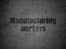 Manufacuring concept: Manufacturing Workers on grunge wall background Royalty Free Stock Photos