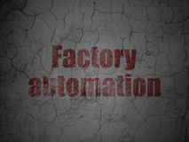 Manufacuring concept: Factory Automation on grunge wall background. Manufacuring concept: Red Factory Automation on grunge textured concrete wall background Stock Image