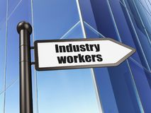 Manufacuring concept: sign Industry Workers on Building background Stock Photography