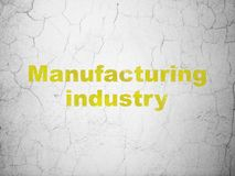 Manufacuring concept: Manufacturing Industry on wall background. Manufacuring concept: Yellow Manufacturing Industry on textured concrete wall background vector illustration