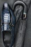 Manuppsättning av modetillbehör, skor, paraply, handskar Fotografering för Bildbyråer