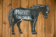 Manure forsake sign on stable door Royalty Free Stock Photography
