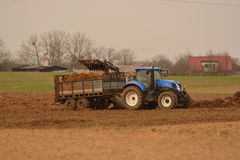 Manure spreader in use Stock Images