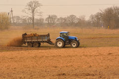 Manure spreader in use Stock Photos