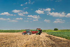 Manure spreader working Royalty Free Stock Photo