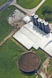 Manure Tank on Dairy Farm Aerial View Detail. Example of a manure tank on a dairy farm. Cows and cattle poop just like anything else and on dairy farms the Stock Images