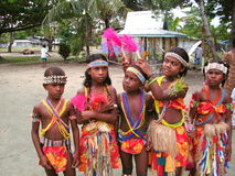 MANUS ISLAND KIDS DANCERS. Manus Island Dancers from Mouk Island of Papua New Guinea. The decorations made from sea shells and plants with traditional paints Royalty Free Stock Photo