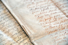 Manuscript. Closeup of manuscript and parchment background Royalty Free Stock Photography