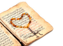 Manuscript Holy Quran and Muslim prayer beads Stock Image