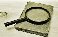 Manuscript and magnifier Stock Photography