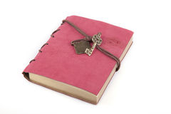 Manuscript. Pink suede manuscript on a white surface. Notebook isolated on white background Royalty Free Stock Image