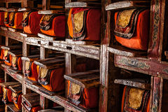 Manuscripts folios in Tibetan Buddhist monastery. Folios of old manuscripts in library of Thiksey Gompa (Tibetan Buddhist Monastery). Ladakh, India stock images