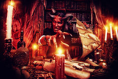 Manuscripts. Horned Devil in his home. Fantasy. Ancient style. Halloween Royalty Free Stock Images