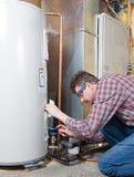 Manutenção do aquecedor de água Imagem de Stock Royalty Free