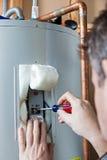 Manutenção do aquecedor de água Fotos de Stock Royalty Free