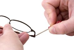 Manutenzione degli occhiali Fotografie Stock Libere da Diritti