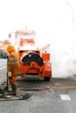 Manutenzione della pavimentazione durante la riparazione degli impianti Immagini Stock Libere da Diritti