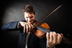 Manviolinist som spelar fiolen Klassisk musikkonst Royaltyfri Fotografi
