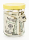 Many 100 US dollars bank notes in a glass jar. Isolated  on white background Royalty Free Stock Images