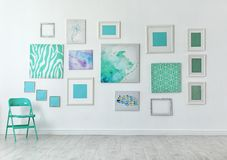 Many abstract mint paintings. On light wall stock image
