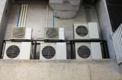 Many Air conditioner compressor installed in old building stock photos