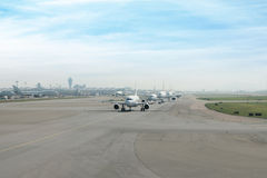 Many airplane prepare takes off from the runway in airport. Royalty Free Stock Photography