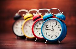 Many alarm clocks, close-up view. Clocks alarm clocks numbers objects business metal sign royalty free stock photo