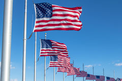 Many American Flags Waving at Washington Monument - Washington, D.C., USA Royalty Free Stock Image