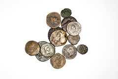 Many ancient bronze and silver coins on a white background Stock Photos