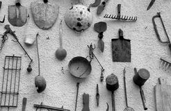 Many ancient farming tools hanging on the wall Royalty Free Stock Images