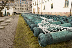 Many ancient metal artillery cannons along the wall Royalty Free Stock Photos