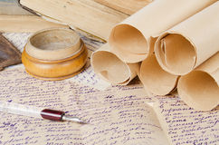 Many ancient scrolls on old letters Royalty Free Stock Photography