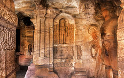 Many ancient sculptures inside the 7th century cave temple in Badami monastic complex of Karnataka, India Stock Photo