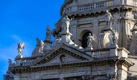 Many Ancient Statues on Venice Church Dome royalty free stock photography