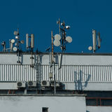 Many antennas on city building. Antennes GSM 3G CDMA UMTS. Stock Photo