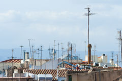 Many antennas on the rooftops Royalty Free Stock Image