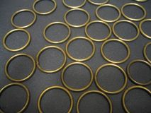 Many antique brass rings stock photo