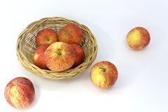 Many apples in the basket isolated on white background. Three apples outside the basket royalty free stock photography