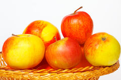 Many apples in a straw basket Stock Image